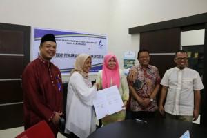 tandatangan mou sekolah slb cendana dengan dispusip pekanbaru